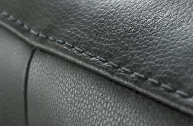Close-up of stitching on a black leather sofa