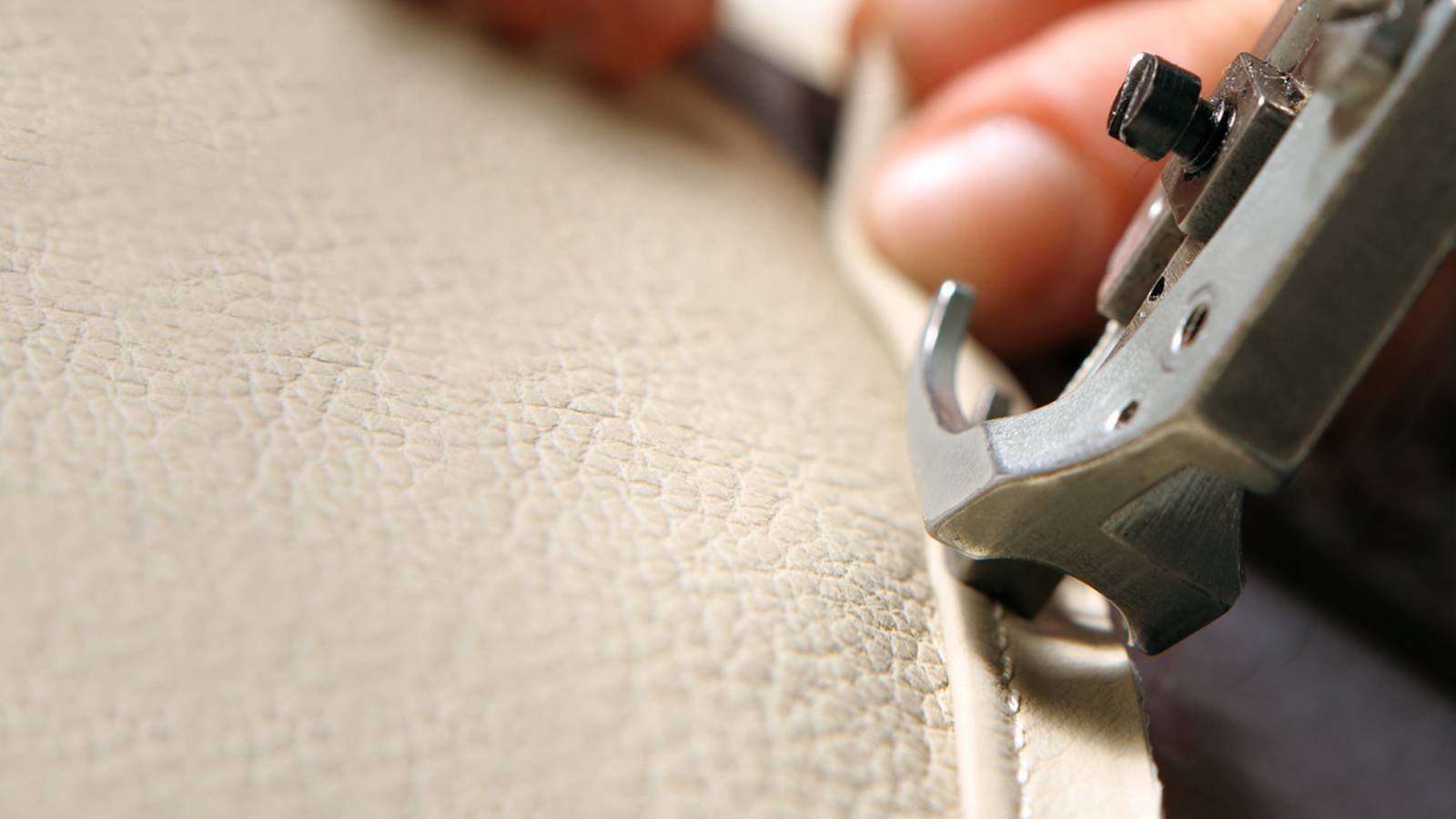 White leather sofa being stitched