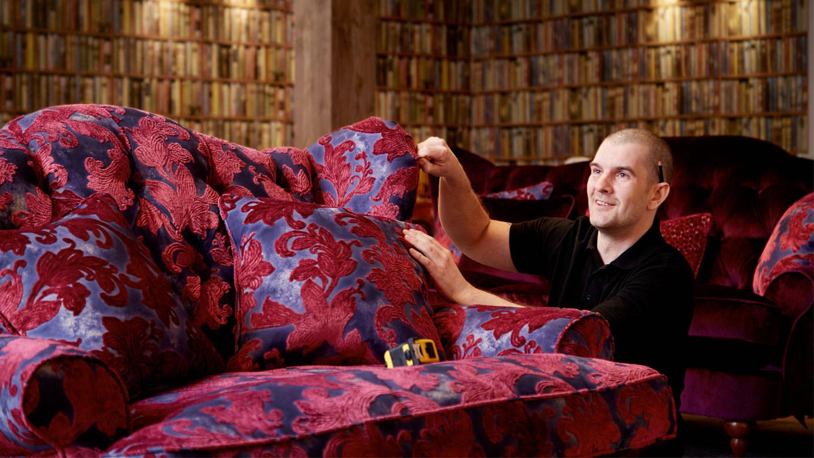 Sofology technician quality testing a sofa