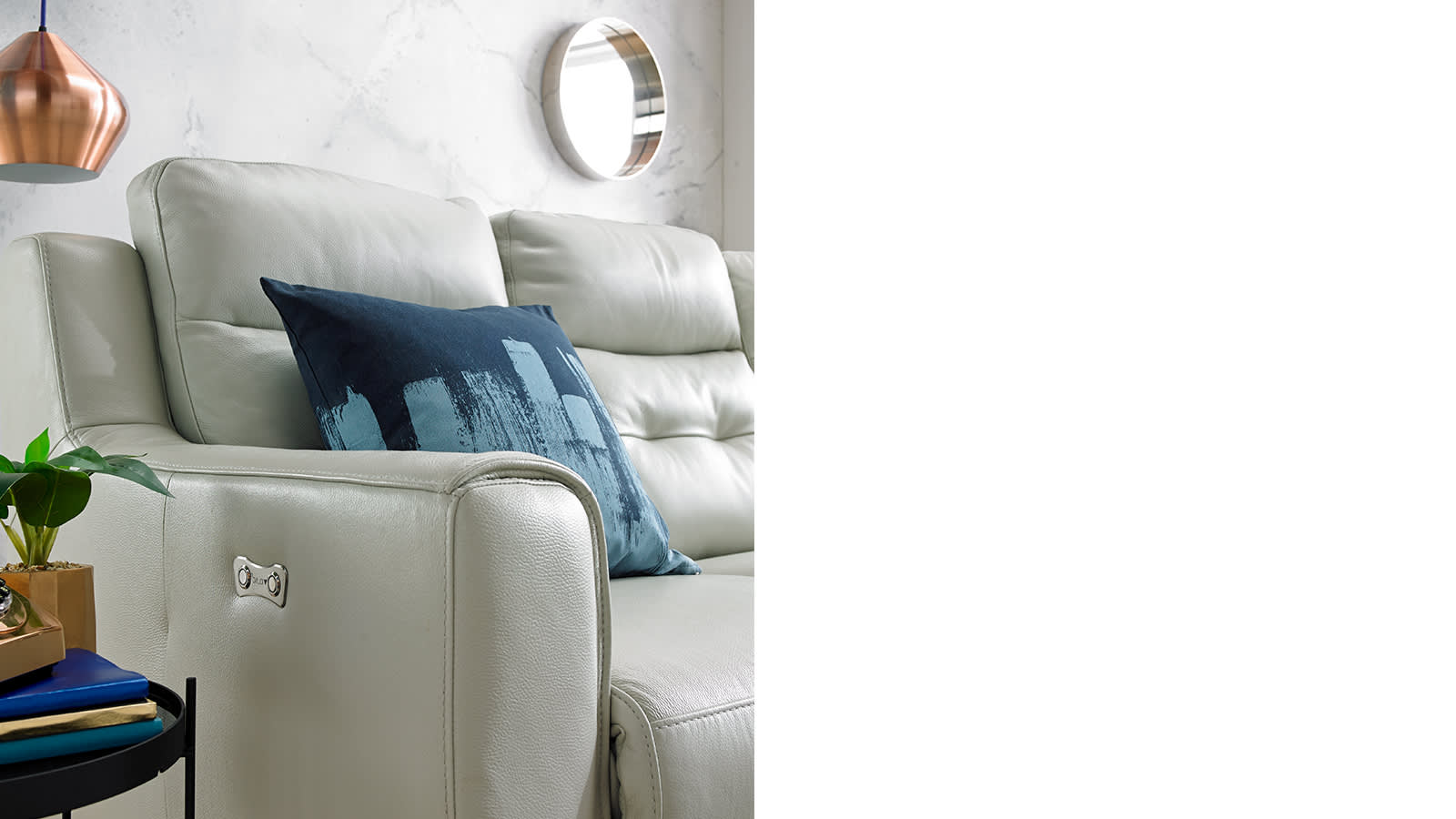 White leather sofa with blue cushion