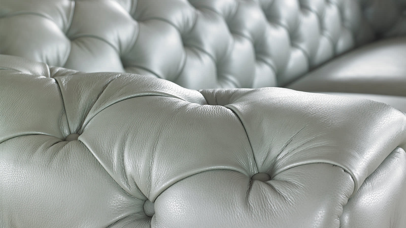 Arm of a white leather sofa
