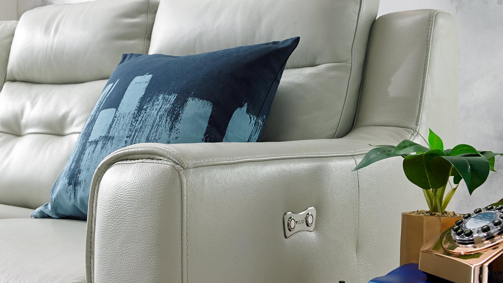 White leather sofa with blue cushion