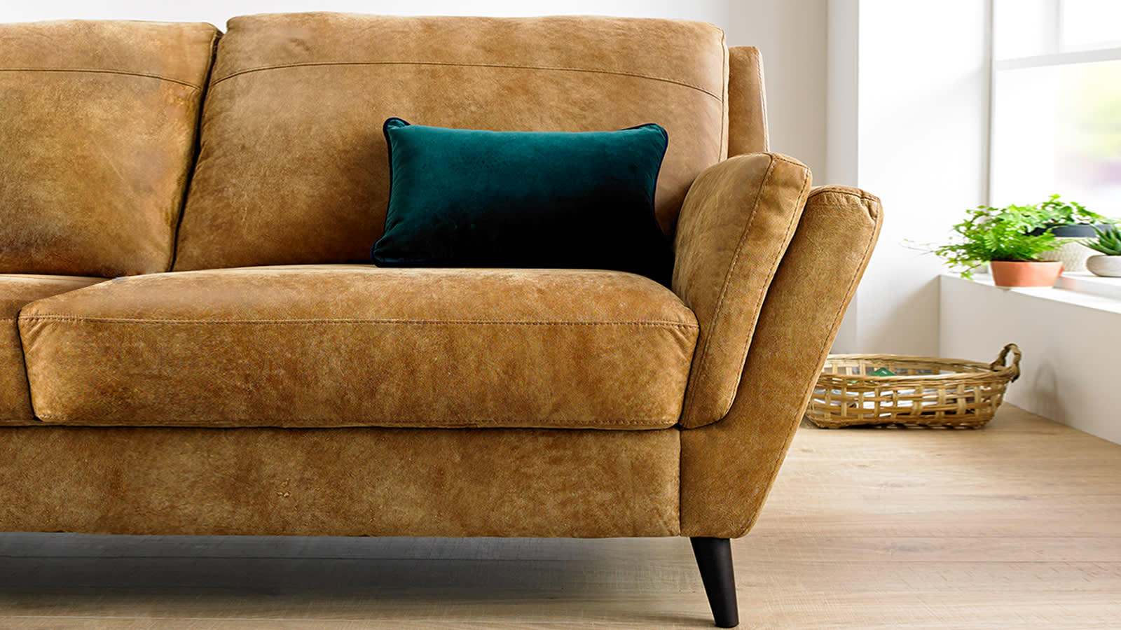 Brown Nubuck leather sofa with green cushion
