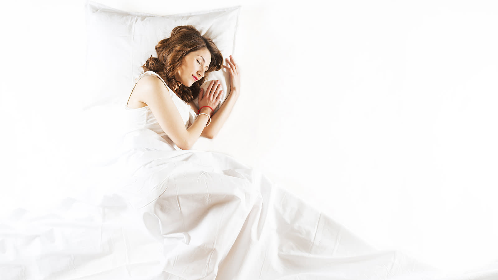Woman sleeping on a Sleepology mattress