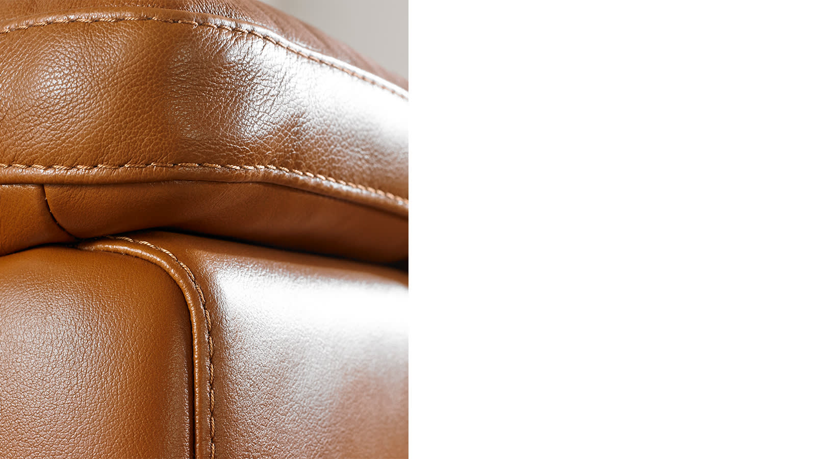 Brown leather stitched sofa