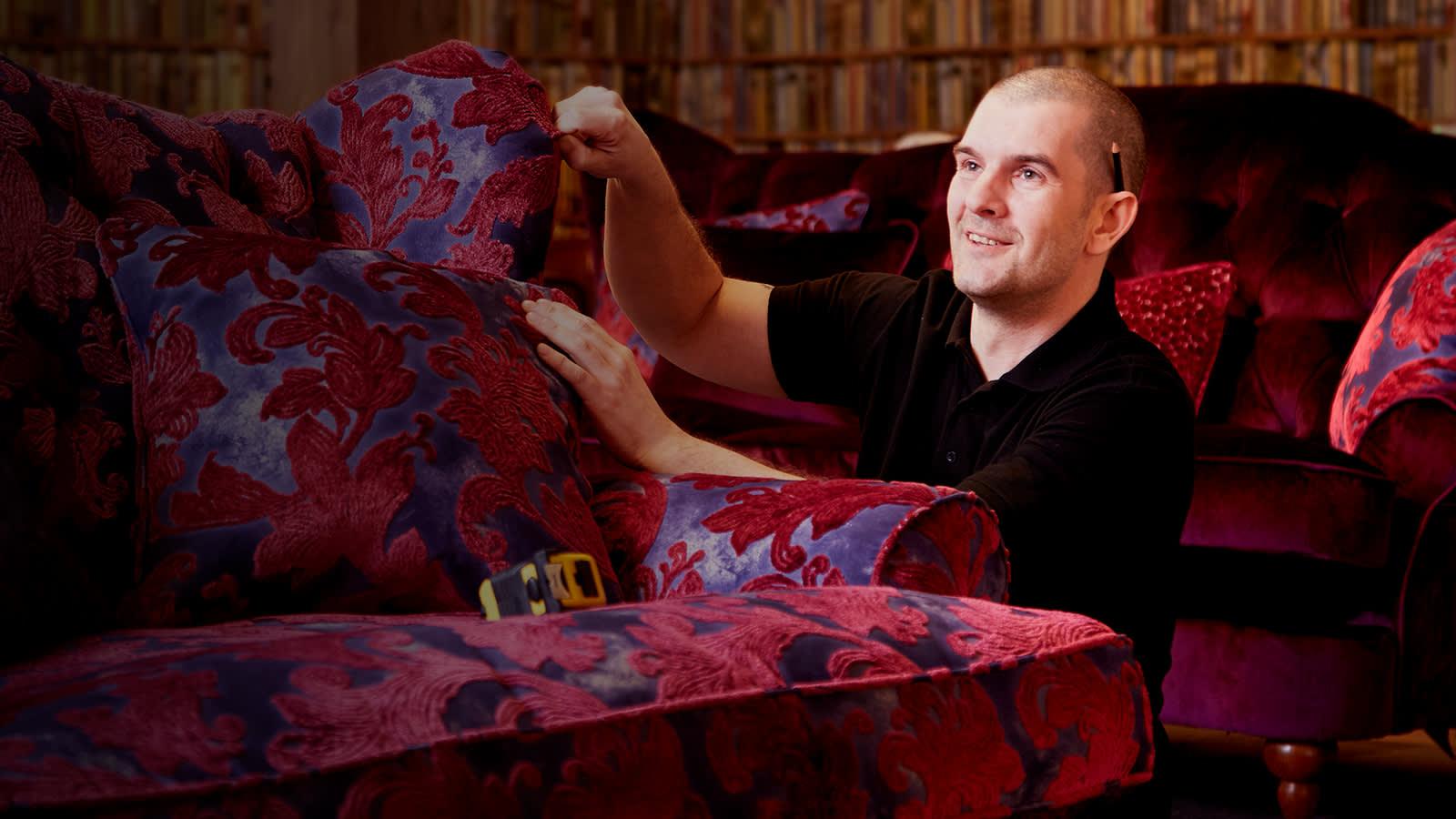 Sofologist repairing sofa