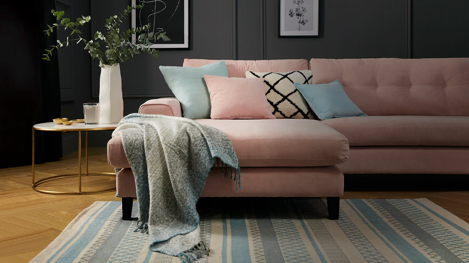 Light pink Demure chaise sofa with light blue throw and scatter cushions