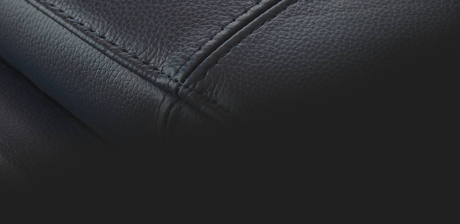 Closeup of dark leather sofa