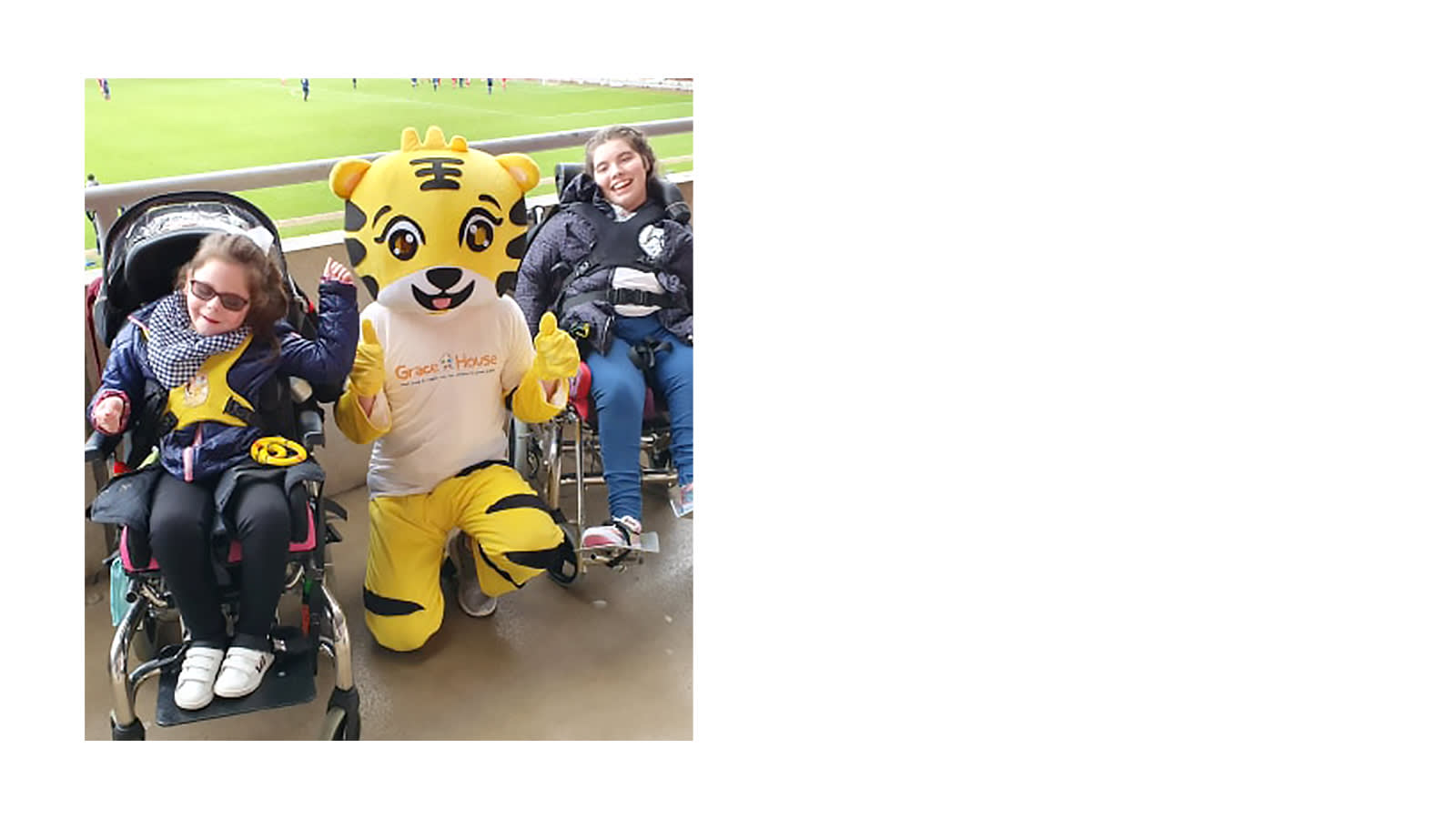 Children with a tiger mascot