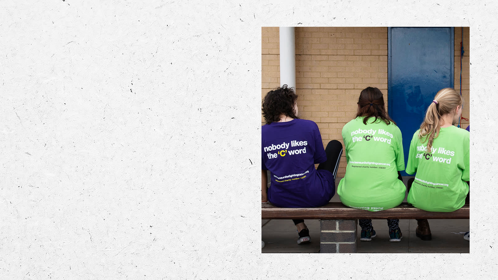 People sitting on a bench wearing Teens Unite tshirts